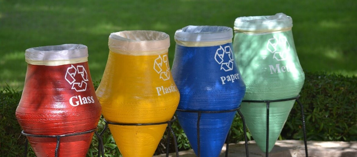 Photo of 4 differently colored recycling bins.