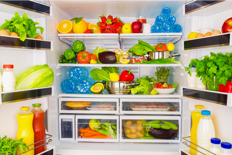 inside of a fridge organized by categories of food
