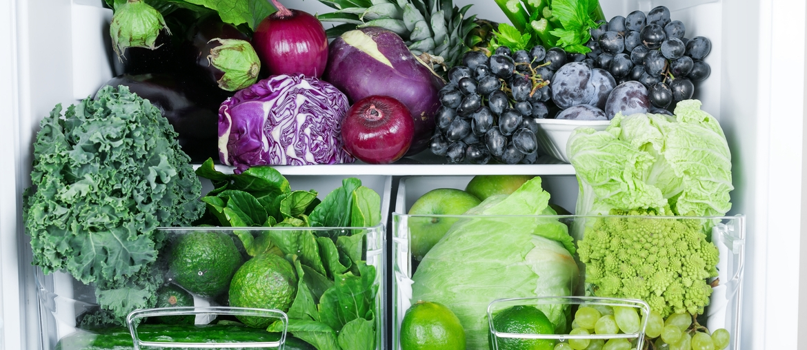 fruits and vegetables in an organized fridge