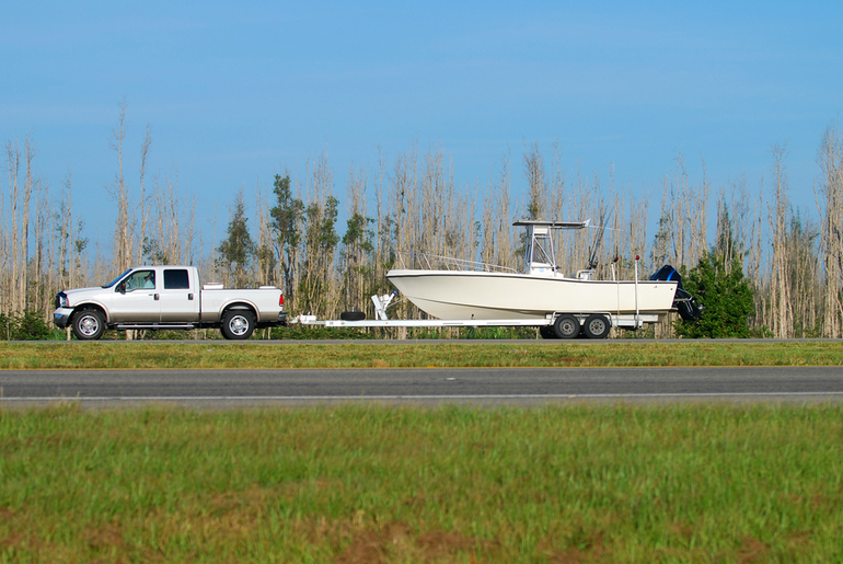 Boat being towed on trailer