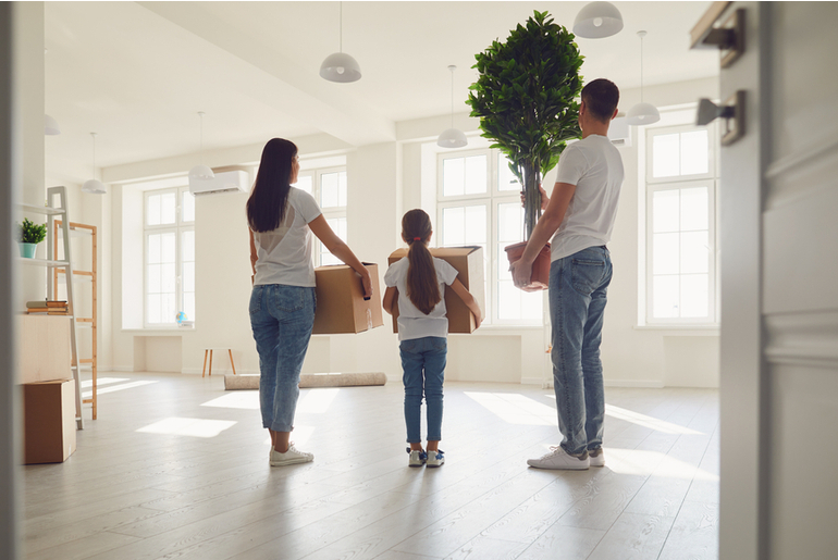Family moving into a specious home with boxes